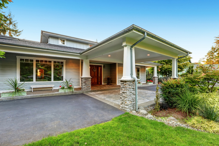 white trim: Luxury house with an all weather covered entry. White column,s with natural stone trim. Northwest, USA