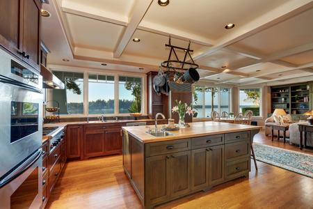 Large kitchen island with hanging pot rack above in open plan kitchen interior. Northwest & Large Kitchen Island With Hanging Pot Rack Above In Open Plan ...