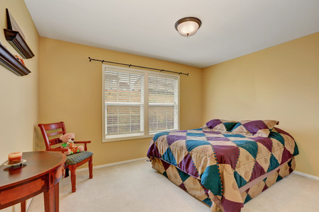 yellow walls: Kids bedroom with colorful bed  and pastel yellow walls. Northwest, USA