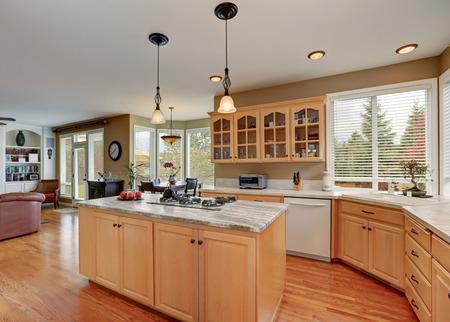 open floor plan: Maple cabinets and large kitchen island. Kitchen room interior. Open floor plan. Northwest, USA
