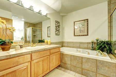 renovated: Luxury bathroom with marble tile and large vanity cabinet. Northwest, USA