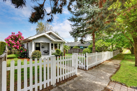 picket: Cute craftsman home exterior with picket fence. Northwest, USA Stock Photo