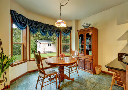 nook: Separate breakfast nook with nice window view, furnished with carved wooden table set for two. Northwest, USA