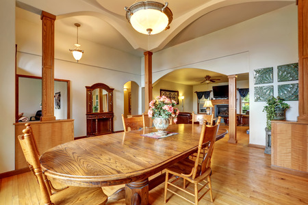 Bright spacious dining room with high ceiling and arches adjacent to the living room. Northwest, USA Stock Photo