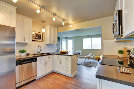 cabinetry: Freshly remodeled kitchen room with white cabinetry and gray counter tops. Northwest, USA