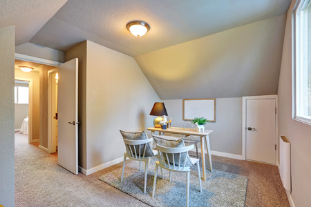 floor lamp: Home office area upstairs with vaulted ceiling and carpet floor. Northwest, USA