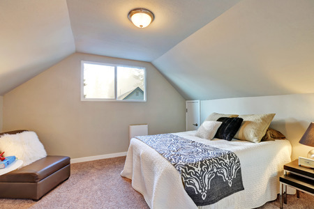 northwest: Attic bedroom with large bed and carpet floor. Northwest, USA