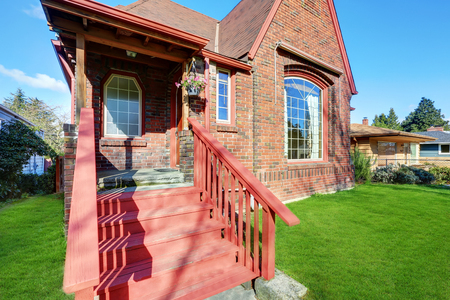 pitched: Classic Tudor style brick  home exterior with steeply pitched roof . Northwest, USA