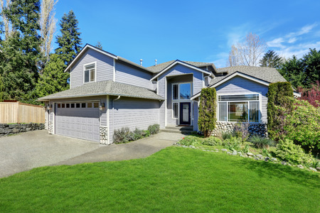 home exterior: Traditional blue home exterior in Puyallup with wood siding and elegant front door. Northwest, USA Stock Photo