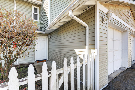 picket fence: Entrance of duplex home with picket fence. Northwest, USA