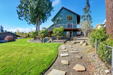 waterfront property: Beautiful waterfront home exterior on Lake Tapps. Northwest, USA