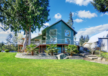 home exterior: Beautiful waterfront home exterior on Lake Tapps. Northwest, USA