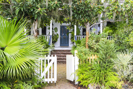 ISLE OF HOPE, GA USA - NOVEMBER 1, 2013: Beautiful homes surrounded by oak trees with Spanish moss in the historic residential district Editorial