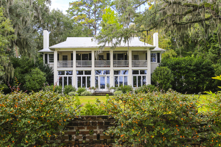 waterfront property: ISLE OF HOPE, GA USA - NOVEMBER 1, 2013: Beautiful homes surrounded by oak trees with Spanish moss in the historic residential district Editorial