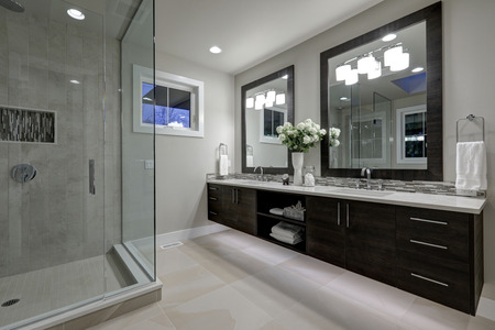 bathroom design: Amazing gray master bathroom with large glass walk-in shower, large dual vanity with mosaic backsplash. Northwest, USA