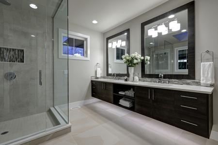 Amazing gray master bathroom with large glass walk-in shower, large dual vanity with mosaic backsplash. Northwest, USA