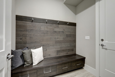 corridors: Gray Foyer features Half wood plank accent wall with built-in storage bench topped with gray and white pillows. Northwest, USA