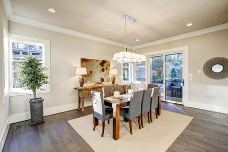 sisal: Lovely dining room with rectangular dining table paired with grey high back dining chairs over sisal rug. Northwest, USA
