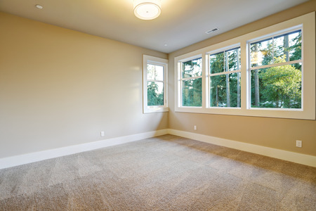 Empty room interior with wall to wall carpet in new construction home. Northwest, USA