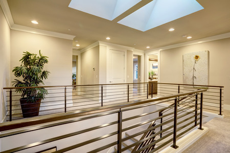second floor: Second floor landing features skylight over the staircase with metal horizontal railings. Northwest, USA