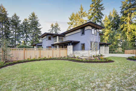 Luxury new construction home with blue siding and natural stone wall trim. Northwest, USA Stock Photo