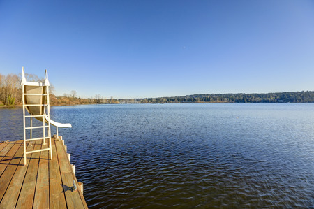 waterfront property: Private dock with a slide in Lake Washington on a bright sunny day. Northwest, USA