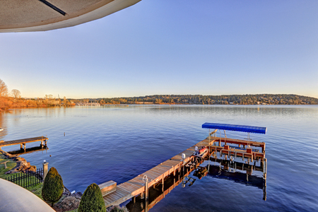 Amazing view of Lake Washington and private dock from the upper balcony of luxurious Mediterranean style waterfront home. Northwest, USA