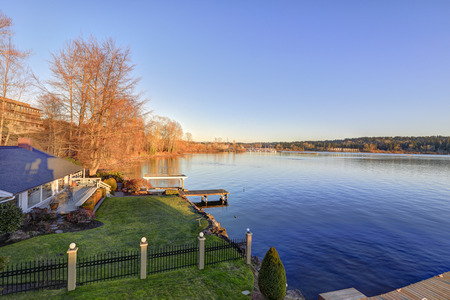 waterfront property: Amazing view of Lake Washington at sunset from the upper balcony of luxurious Mediterranean style waterfront home. Northwest, USA