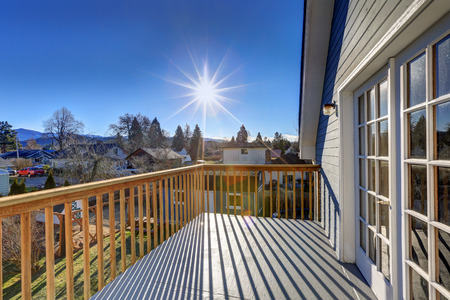 second floor: Exterior of blue craftsman house with nice view from the second floor deck. Northwest, USA