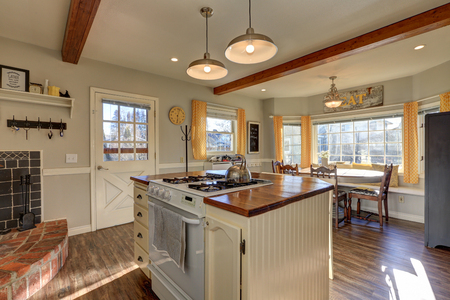 renovated: Newly renovated Kitchen boasts wood beams on ceiling, pale grey walls, white island with wood counter top and hardwood floor. Northwest, USA