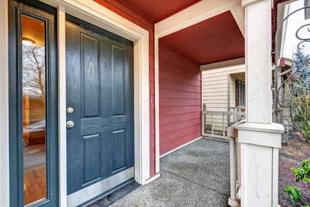 huge: Covered red porch with dark blue accent front door with sidelights. Northwest, USA