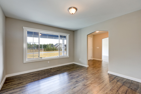 Empty rambler home interior with grey walls paint color and laminate floor. View of the foyer with entrance door. Northwest, USA Stock Photo