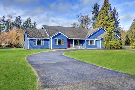 rambler: Beautiful rambler house with tile roof, blue siding and well kept lawn in the front yard. Northwest, USA
