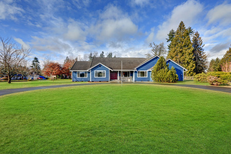 rambler: Beautiful rambler house with tile roof, blue siding and well kept lawn. Northwest, USA