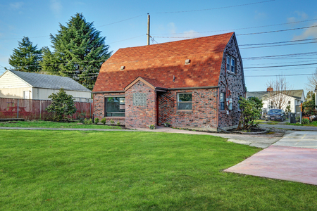 Small red brick home on a sunny day. Northwest, USA