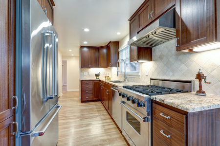 renovated: Classic kitchen with brown cabinets, granite counters and stainless steel appliances. Northwest, USA