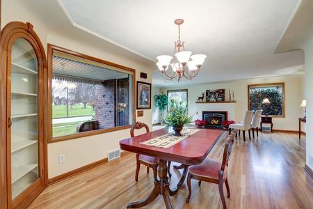 Open floor dining room with vintage table set and light hardwood floor. Northwest, USA