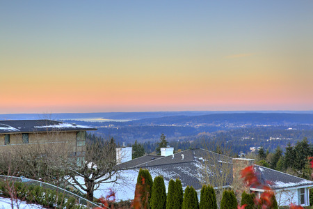 View from the upper deck of two story home presenting breathtaking picturesque scenery with panoramic view of Bellevue downtown