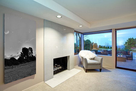 Lovely bedroom design in soft beige and cream tones boasts traditional fireplace with white tile fireplace surrround and glass sliding doors to amazing poolside patio space. Northwest, USA