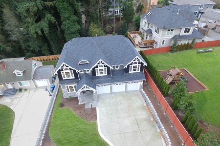 lot of: Aerial view of luxurious grey and blue home  in residential area of Bellevue downtown. Northwest, USA Stock Photo