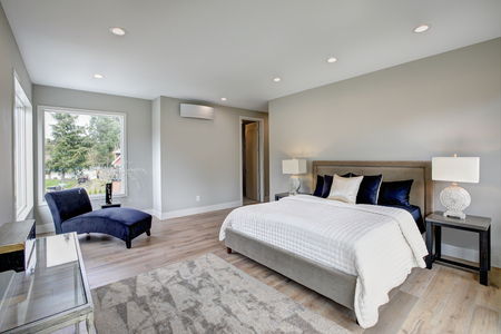 Master bedroom interior with private balcony in a new construction home. Northwest, USA Stock Photo