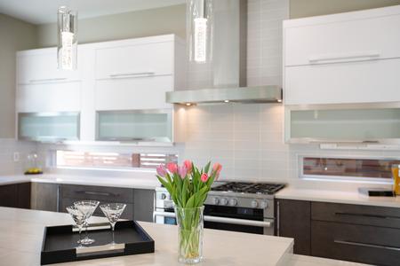 Luxury kitchen � natural backsplash, white quartz, natural brown wood cabinets and lots of light. Northwest, USA