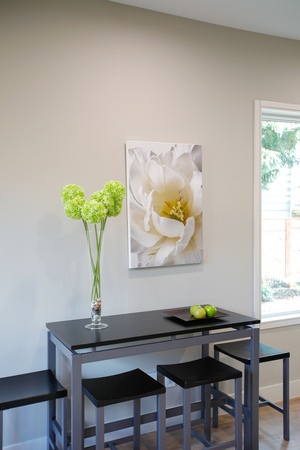 Light Breakfast nook showcases black table with stools and a nice large framed flower print on the wall. Northwest, USA