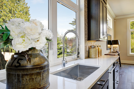 renovated: Lovely kitchen features a stainless steel sink paired with elegant gooseneck faucet placed under the window which opens to the expansive backyard. Northwest, USA