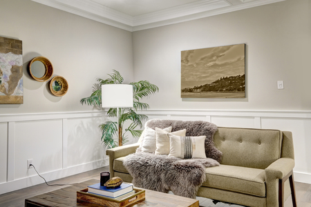 Lovely Craftsman Style Living Room With Coffered Cealing Over Light Beige  Walls With Board And Batten