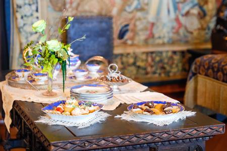 ASHEVILLE, NORTH CAROLINA - MARCH 4, 2017:  Biltmores film  exhibition. Afternoon tea at Biltmore House, Mrs. V personal Tea Set.