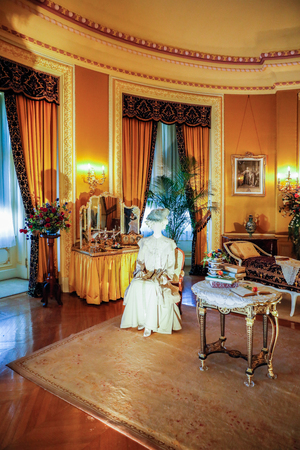 ASHEVILLE, NORTH CAROLINA - MARCH 4, 2017: Biltmores costume exhibition. The House of Mirth is featured in Mrs Vanderbilts bedroom. Costumes arranged with mirrors to see the backs of both.