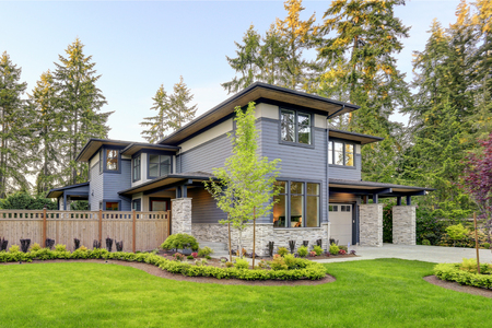 Luxurious new home with curb appeal. Trendy grey two-story mixed siding exterior in Bellevue with a hip roof and large picture windows. Northwest, USA