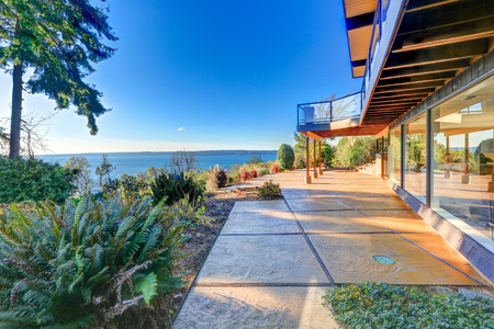 Modern two story panorama house with Puget Sound view at sunset. Northwest, USA