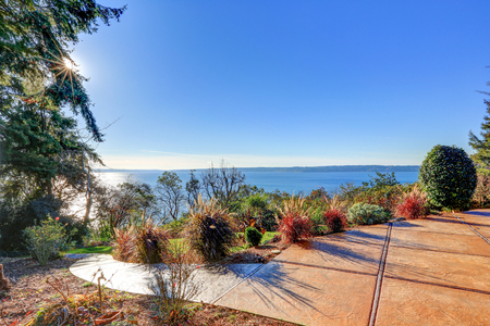 Exterior of panorama house with gorgeous view of Puget Sound, view from the perfectly kept backyard. Northwest, USA